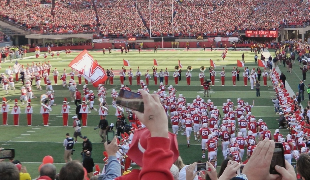 Husker taking the field against Minnesota, 2012, Tom Osborne's last home game. As you can see, a lot of people were out to capture the magic for themselves.