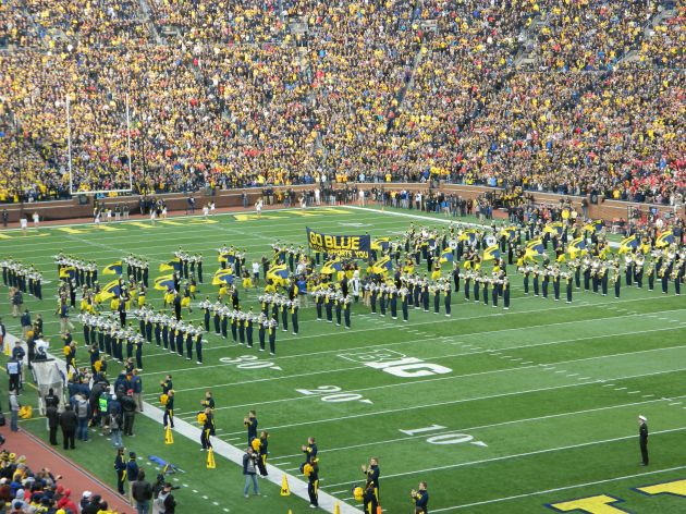 Wolverines taking the field under their famed banner...